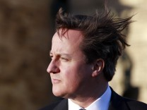 Britain's Prime Minister David Cameron speaks to members of the media at a press conference outside Stormont Castle,