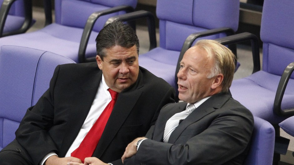 SPD leader Gabriel talks with the Green party parliamentary faction leader Juergen Trittin