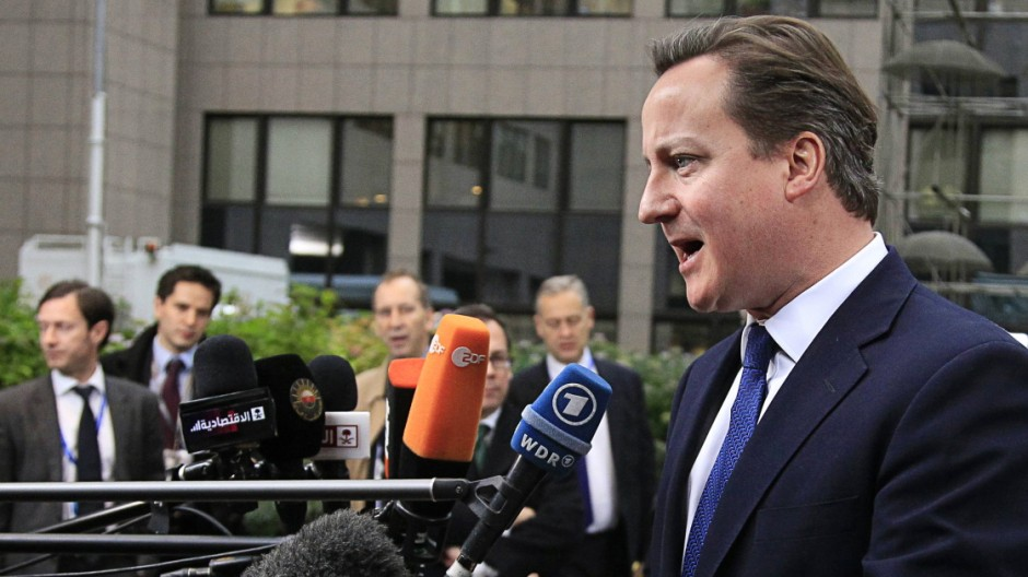 Britain's PM Cameron speaks to the media as he arrives at the EU council headquarters for an EU leaders summit discussing the EU's long-term budget in Brussels
