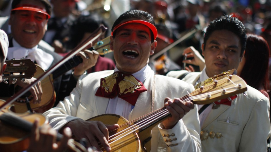 Mariachis play guitar during a pilgrimage to the Basilica of Our Lady of Guadalupe in Mexico City