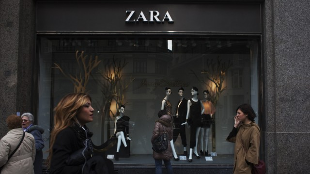 People walk by one of Zara's stores in central Madrid
