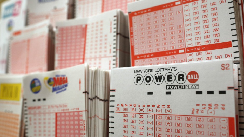 Cards for lottery customers to pick their own numbers are stacked on a rack at a store where people buy tickets for the Powerball lottery in New York