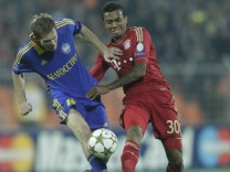 BATE Borisov's Hleb fights for the ball with Bayern Munich's Gustavo during their Champion's League Group F soccer match in Minsk's Dinamo Stadium