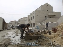 Palestinian labourers work at a construction site in the Jewish settlement of Maale Adumim