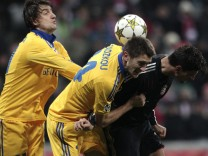 Bayern Munich's Gomez fights for the ball with BATE Borisov's Radkov and Filipenko during Champions League Group F soccer match in Munich