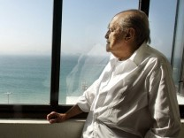File photo of Brazilian architect Oscar Niemeyer looking at the Copacabana beach in Rio de Janeiro