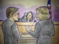 Samsung attorneys Charles Verhoeven and Kathleen Sullivan speak in front of U.S. District Judge Lucy Koh during court proceedings in San Jose