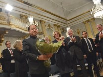 2012 Nobel Literature Prize laureate Mo of China receives flowers and applause from members of academy during traditional Nobel lecture at Royal Swedish Academy