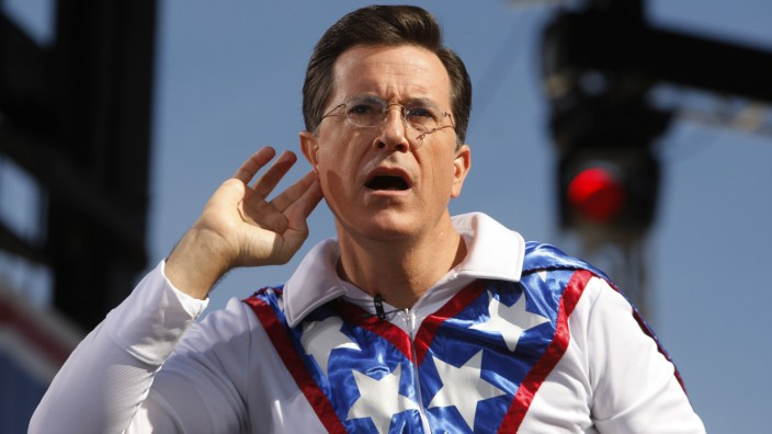 Comedian Stephen Colbert gestures during rally on the National Mall in Washington