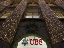 Christmas lights are illuminated at an office building of Swiss bank UBS in Zurich