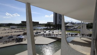 People line up in front of Planalto Palace to attend the funeral of Niemeyer in Brasilia