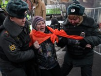 Police detain political protestors