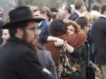 Veronique Pozner is hugged after the funeral services for her son Noah Pozner, the youngest victim of the Sandy Hook Elementary School shooting, in Fairfield, Connecticut
