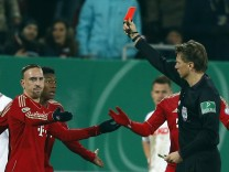 Munich's Ribery is shown a red card by referee Kinhoefer during their German DFB Cup (DFB Pokal) round of sixteen soccer match in Augsburg