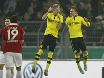 Goetze and Reus of Borussia Dortmund celebrate Goetze's goal against Hanover 96 during their German DFB Cup (DFB Pokal) soccer match in Dortmund
