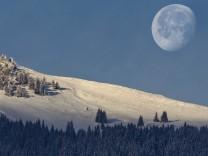 Moon sets, sun rises in Switzerland