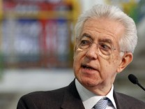 Italy's PM Monti looks as he makes his speech during a visit to the Fiat car factory in the southern city of Melfi