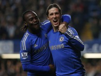 Chelsea's Torres celebrates his goal against Aston Villa with Moses during their English Premier League soccer match in London