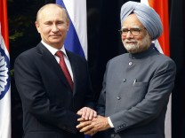 Russia's President Putin shakes hands with India's Prime Minister Singh during their meeting in New Delhi