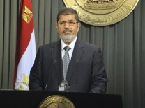 Egypt's President Mursi speaks to nation after signing Egypt's new constitution in Cairo