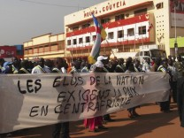Residents of Central African Republic participate in a marching protest along the streets of the capital Bangui