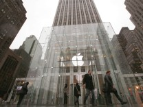 Customers are seen outside the Fifth Avenue Apple store in New York