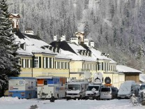 Television broadcast vans are parked in front of conference building during annual Epiphany meeting in Wildbad Kreuth