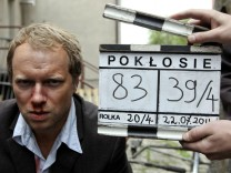 Polish actor Maciej Stuhr looks into a camera on set of the movie 'Poklosie' near Warsaw