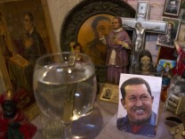 A picture of Venezuela's President Hugo Chavez rests on a religious altar in Caracas