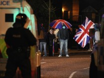 Loyalist protesters block Cregagh Road in East Belfast after a decision was made to remove the British flag from Belfast's City Hall