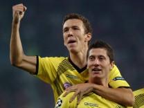 Borussia Dortmund's Lewandowski and Perisic celebrate a goal against Olympiakos during their Champions League soccer match at Karaiskaki stadium in Piraeus near Athens