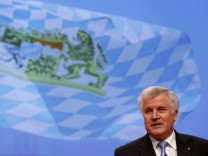 Seehofer, Prime Minister of Bavaria and party leader of the Christian Social Union (CSU) delivers his speech during the second day of Germany's Christian Democratic Union (CDU)'s annual party meeting in Hanover