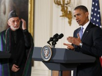 US-Präsident Obama mit Afghanistans Präsident Hamid Karsai bei einem Treffen in Washington.
