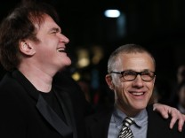 Director Quentin Tarantino shares a light moment with actor Christoph Waltz at the UK premiere of Django Unchained in central London