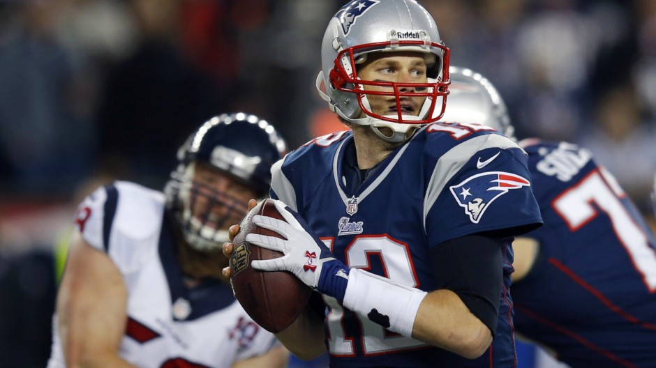 New England Patriots quarterback Tom Brady looks down field as he prepares to pass during the first quarter of their NFL AFC Divisional playoff football game against the Houston Texans in Foxborough