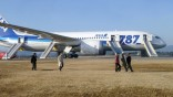 Passengers walk away from All Nippon Airways' (ANA) Boeing Co's 787 Dreamliner plane which made an emergency landing at Takamatsu airport, western Japan