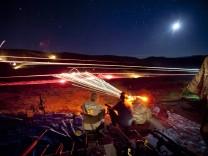 Gun Enthusiasts Gather for Machine Gun Shoot in Rural Arizona