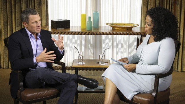 Handout photo of Lance Armstrong speaking with Oprah Winfrey in Austin