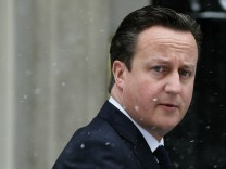 Britain's Prime Minister Cameron leaves Number 10 Downing Street in central London