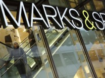 A couple shop at British retail chain Marks & Spencer in the financial district City of London