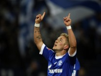 Schalke 04's Holtby celebrates a goal against Hannover 96 during the German first division Bundesliga soccer match in Gelsenkirchen