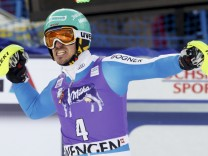 Neureuther of Germany celebrates after the second run of the men's Alpine Skiing World Cup slalom race in Wengen