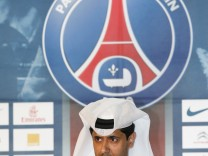 Paris St Germain's President al-Khelaifi attends a news conference to present Lucas Moura of Brazil, newly signed player for the French soccer club, in Doha