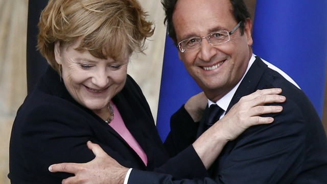 File photo of France's President Francois Hollande and German Chancellor Angela Merkel