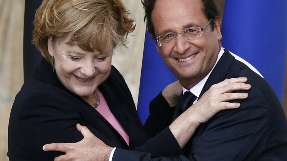 File photo of France's President Francois Hollande and German Chancellor Angela Merkel