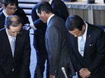 Bank of Japan Governor Shirakawa, Finance Minister Aso and Economics Minister Amari greet each other at the conclusion to their joint news conference in Tokyo