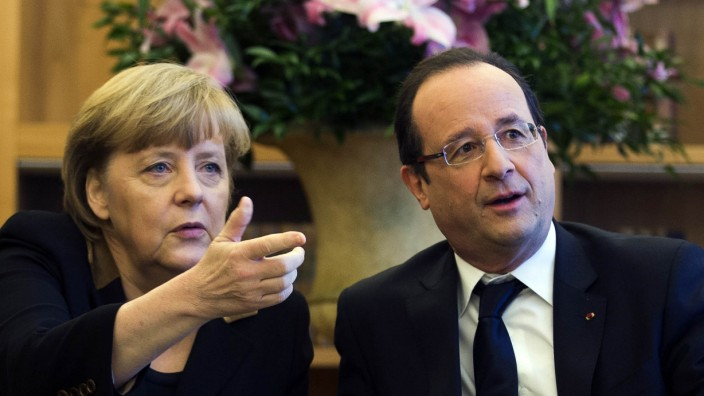 German Chancellor Merkel and French President Hollande meet French and German cultural representatives in Berlin