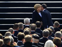 File photo of France's President Hollande and Germany's Chancellor Merkel at anniversary ceremony in castle Ludwigsburg