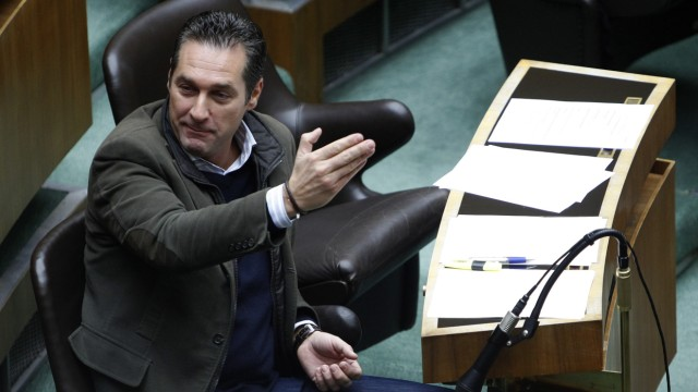 Head of FPOe Party Strache  gestures during a session of the parliament in Vienna