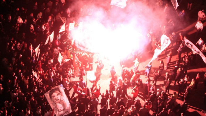 Protesters against Egypt's President Mohamed Mursi light fireworks as they gather at Tahrir Square in Cairo